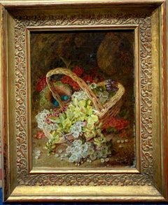 English still life Flowers and birds nest by a Basket on a moss bank