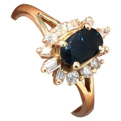 Vintage 0.59 Carat Oval Sapphire and Diamond Ring in 14 Karat Yellow Gold