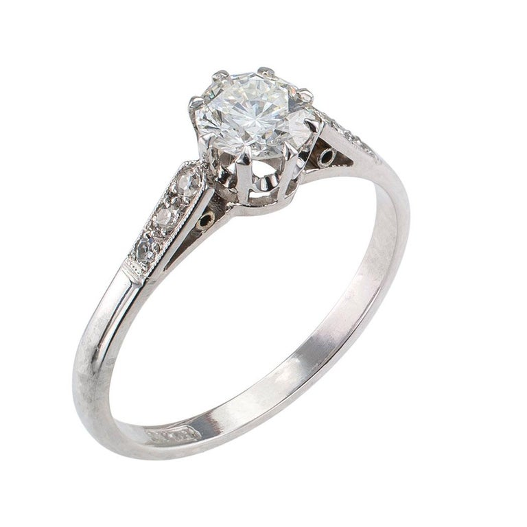 Vintage 0.85 carat diamond and platinum solitaire engagement ring circa 1950. DETAILS: Diamond and platinum solitaire engagement ring. DIAMOND: approximately 0.85 carat, approximately G – H color and SI clarity. DIAMONDS: six smaller round diamonds