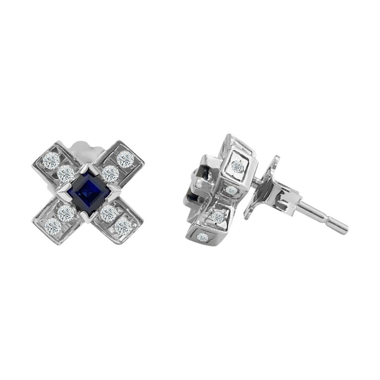 Metal: 14k white gold.   Diamonds:  0.60 cwt. VS clarity and G color. Round brilliant cut diamonds.  100% natural earth mined   Blue sapphire: 0.40 cwt. Princess cut set in prongs. 100% natural earth mined.   TCW of all stones: 1.00