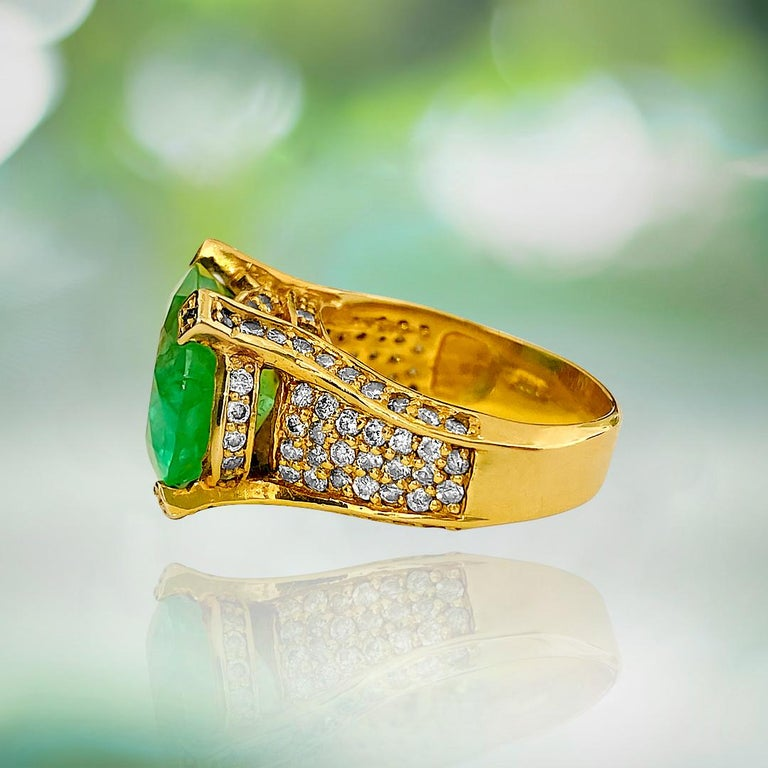 Metal: 14K yellow gold.   11.50 carat Colombian emerald, oval cut. 100% natural earth mined emerald set in prongs. Deep and intense saturation in the emerald.   1.50 TCW diamonds. SI clarity and G color. 100% natural earth mined and genuine round