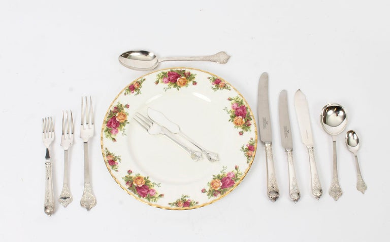 Comprehensive Roberts & Belk twelve place settings silver plated William & Mary pattern cutlery in a mahogany canteen dated 1981 / 82.