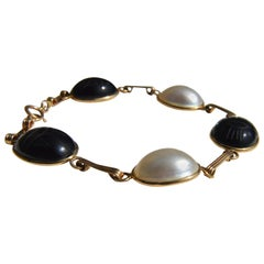 Vintage 14 Karat Gold Mother of Pearl and Onyx Scarab Bracelet