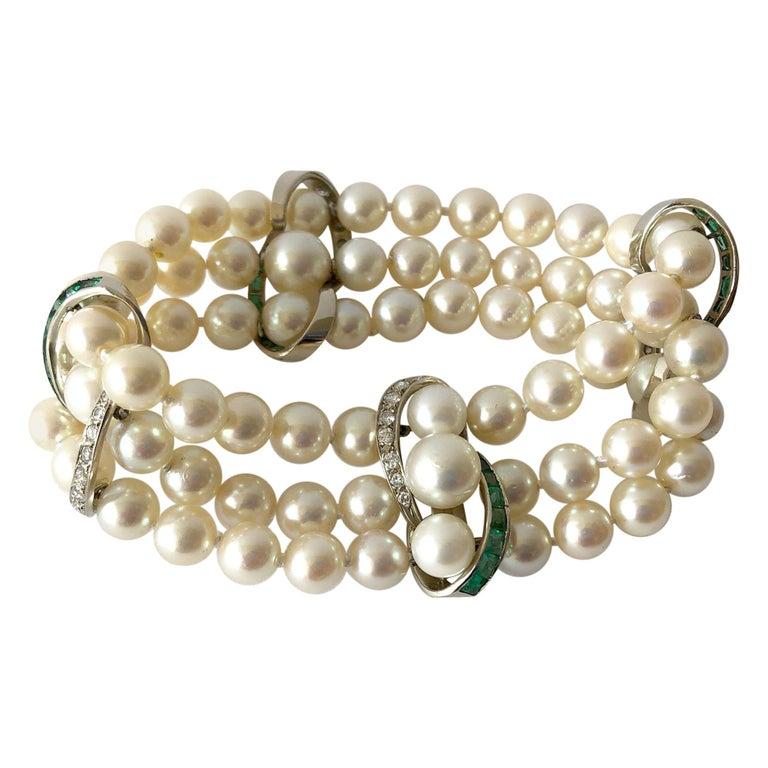 Vintage 14 Karat White Gold 1960s Diamond Emerald Pearl Three-Strand Bracelet For Sale