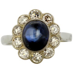 Vintage 14 Karat White Gold Ladies Ring with Cabochon Blue Sapphire and Diamonds