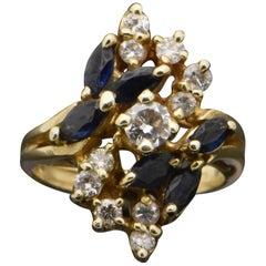 Vintage 14 Karat Yellow Gold Diamonds and Sapphires Ring