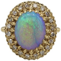 Vintage 14 Karat Yellow Gold Opal and Diamond Halo Cocktail Ring