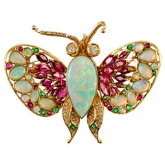 Vintage 14 Karat Yellow Gold Opal Ruby Emerald and Diamond Butterfly Brooch Pin