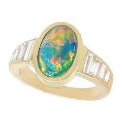 Vintage 1.40 Carat Opal 1.12 Carat Diamond Yellow Gold Cocktail Ring