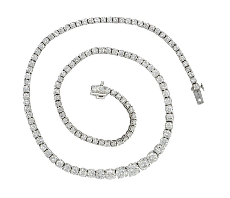Dazzling riviera style necklace with individual baskets as links  Fully articulated and prong set with round brilliant cut diamonds that graduate in size  Largest central diamonds weighs approximately 0.85 carat; H/I color with VS clarity  Remaining