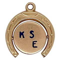 """Vintage 14K Gold Charm of a Spinning """"Kiss Me"""" Horseshoe for a Charm Bracelet"""