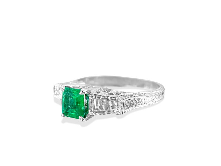 Metal: 14K white gold.  Center: 1.50 carat emerald. 100% natural earth mined Colombian Emerald. Cut: Princess. Beautiful saturation and color.   Side diamonds: 0.30 carat diamonds total. VS clarity and F color diamonds. Baguette cut and round