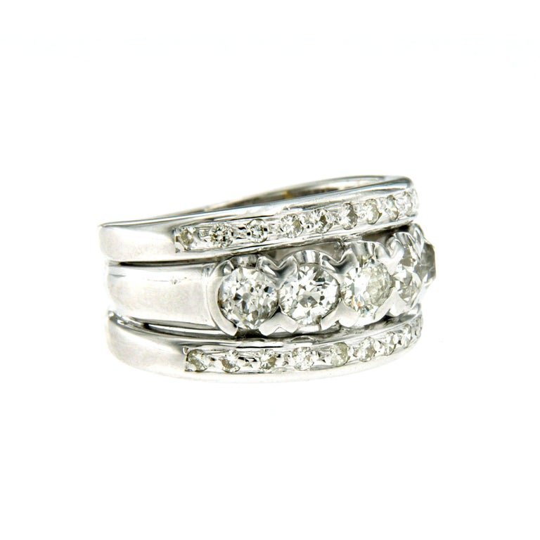 A vintage diamond band ring set in 18k white gold. The ring features total 1.50 carat round brilliant cut diamond graded H color Vs clarity, simple but luxurious, it's perfect for everyday wear. Entirely hand crafted, dates to the 1980s, Italy, and