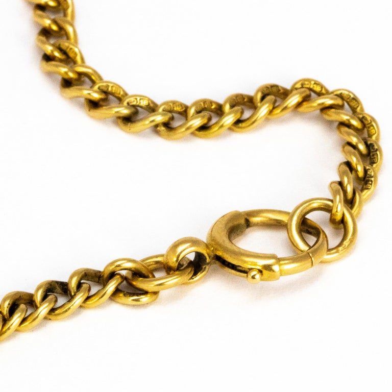 This delicate curb chain bracelet is slim and modelled in glossy 18ct gold. The bracelet is fastened by simple clasp and loop. Each link is hallmarked.   Length: 18.5cm Width: 4mm