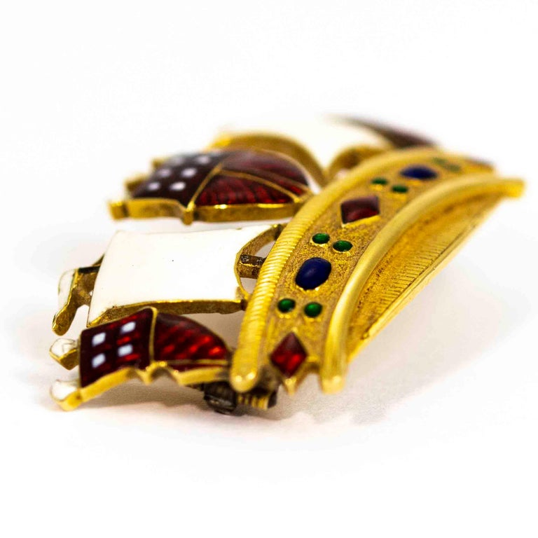 An exquisite vintage brooch modelled in the shape of a crown. Wonderfully decorated with pristine enamel resembling gemstones and fabric. Modelled in 18 carat yellow gold.  Dimensions: 38mm x 22mm