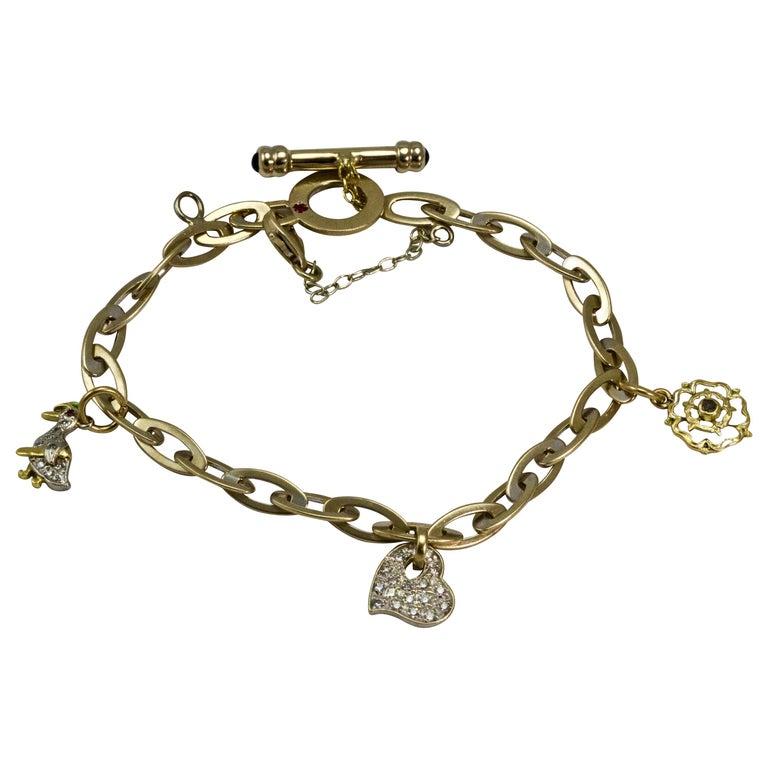 15c93ee9ff542 Vintage 18 Carat Roberto Coin Diamond Sapphire Enamel and Ruby Charm  Bracelet