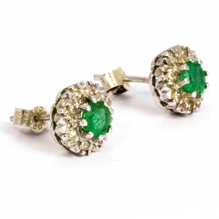 Round Cut Vintage 18 Carat White Gold Emerald and Diamond Cluster Earrings For Sale