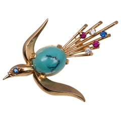 Vintage 18 Karat Bird in Flight Brooch Turquoise Sapphire and Rubies, circa 1960