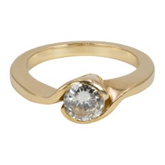Vintage 18 Karat Gold and 0.7 Carat Round Cut Diamond Solitaire Ring, 1970s