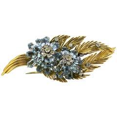 Vintage 18 Karat Gold Floral Brooch with Aquamarine and Diamonds, circa 1950s