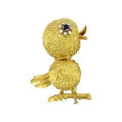 Vintage 18 Karat Gold Ladies Bird Brooch with Blue Sapphire and Diamonds Eye