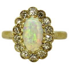 Vintage 18 Karat Gold Ladies Ring with Natural Opal and Old Cut Diamonds