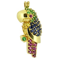 Vintage 18 Karat Gold Parrot Brooch with Blue Sapphires, Emeralds and Rubies