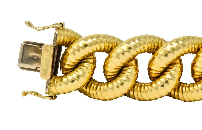 Designed as large, hollow, ribbed curb links throughout  With concealed clasp and double figure-eight safeties  With maker's mark  Stamped 750 for 18 karat gold  Length: 7 3/4 inches  Width: 1/2 (widest) inch  Total weight: 50.0 grams  Chunky.