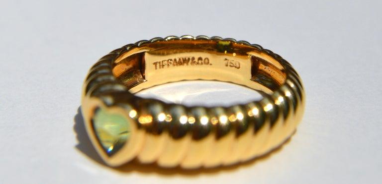 Heart Cut Vintage 18 Karat Gold Tiffany & Co .44 Carat Peridot Ribbed Heart Band Ring For Sale