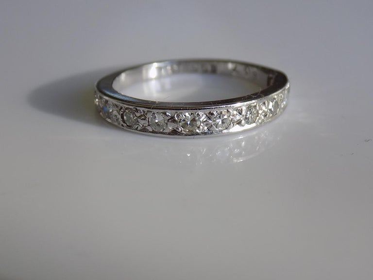 A Vintage c.1977 18 Carat Goild and Diamond half eternity band. London hallmarks. English origin. Size K UK, 5.5 US. Height of the face 3mm. Weight 2.8gr. Full London hallmark. Very good condition and ready to wear.