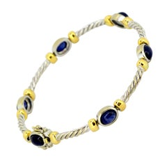 Vintage 18 Karat White Gold Ladies Bracelet with Cabochon Blue Sapphires