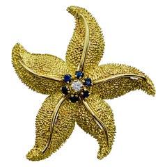Vintage 18 Karat Yellow Gold Diamond and Blue Sapphire Starfish Brooch