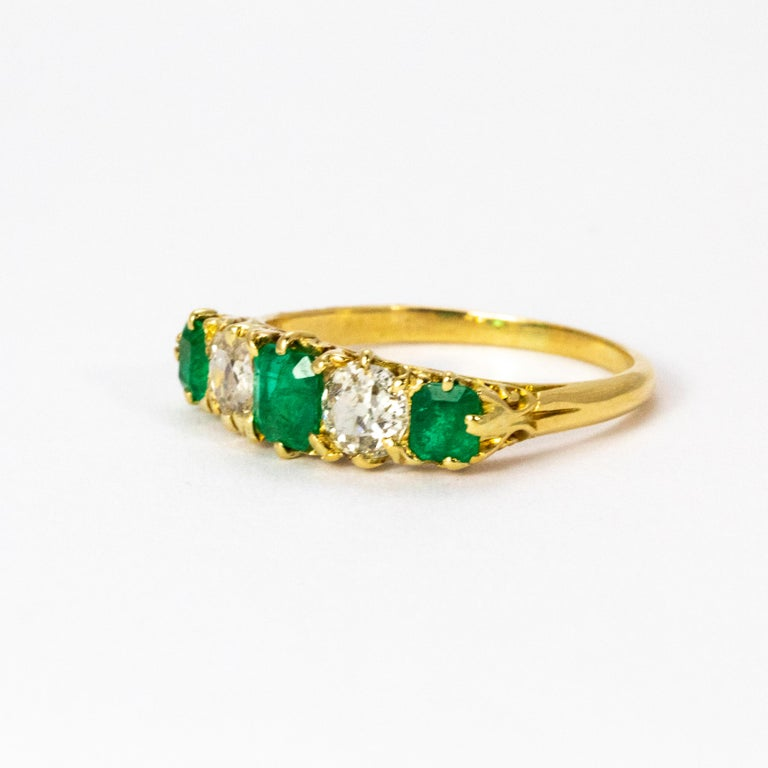 A stunning Vintage five-stone ring set with alternating white diamonds and green emeralds, all beautifully modelled in 18 karat yellow gold. Total diamond weight 1.02 carat.  Ring size: 9 or R