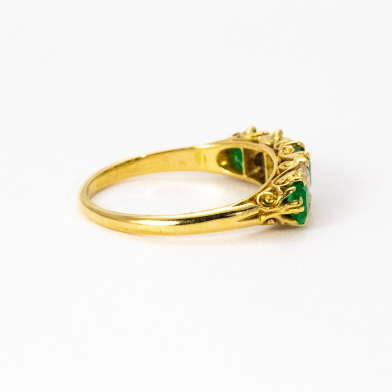 Vintage 18 Karat Yellow Gold Diamond and Emerald Five-Stone Ring In Excellent Condition For Sale In Chipping Campden, GB