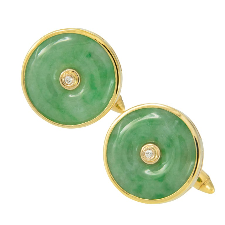 Jade, or The Emperor's Stone, has been a symbol of status, purity & health with ancient kingdoms starting wars over significant jade pieces. These handsome classic green jade cufflinks are made from rich 18 karat yellow gold with the simple elegance
