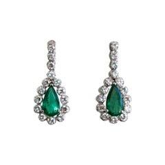 Vintage 1.80 Carat Emerald and Diamond Dangle Earrings in 18 Karat White Gold