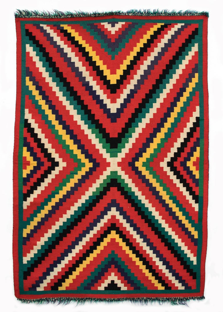 Authentic vintage 19th century circa 1890 Navajo blanket textile woven of Germantown Yarns in an Eye dazzler pattern of vibrant colors including red, green, yellow, black and white. Germantown textiles like this were woven by Native American Navajo