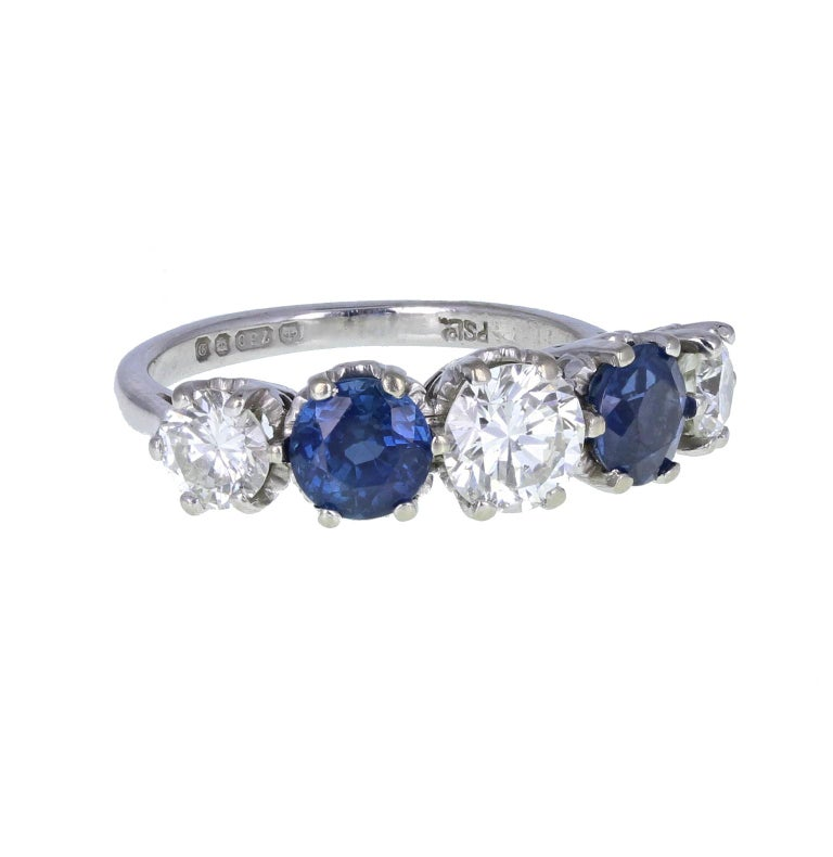 Modern Vintage 18 Carat White Gold Blue Sapphire Diamond Five-Stone Ring For Sale