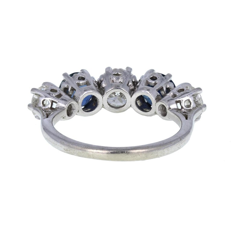 Round Cut Vintage 18 Carat White Gold Blue Sapphire Diamond Five-Stone Ring For Sale