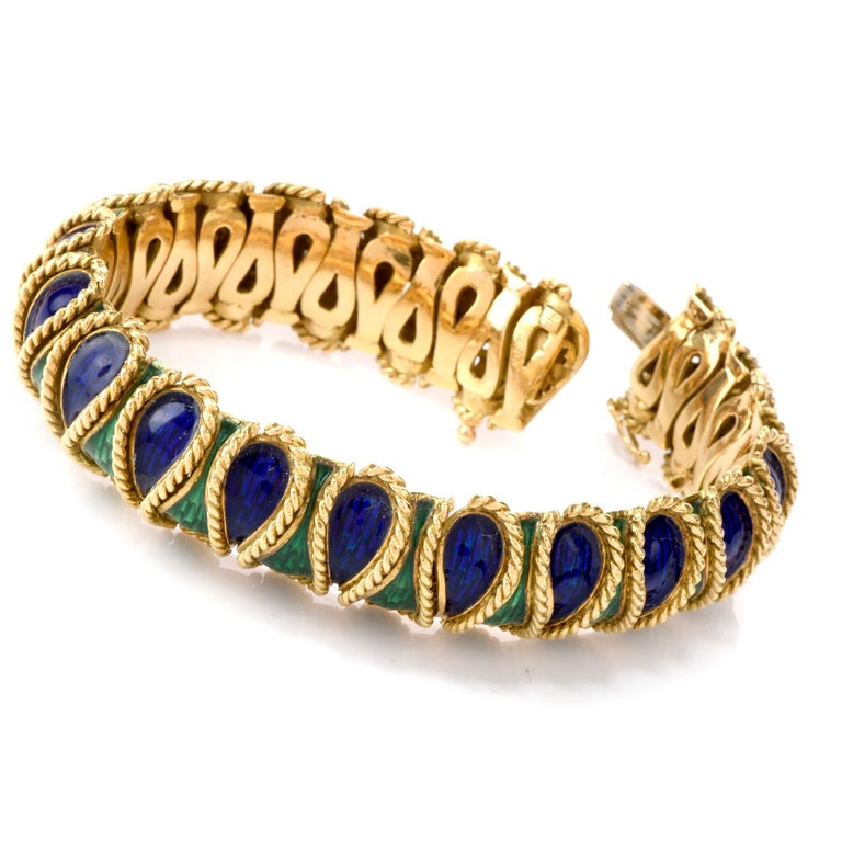 This statement Bracelet offering flexibility with color and style was  inspired in a Serpent motif and crafted in 98.1 grams of luxurious 18K yellow gold.  A prevalent wrapping pattern of twisted rope separate the alternating enameled panels of