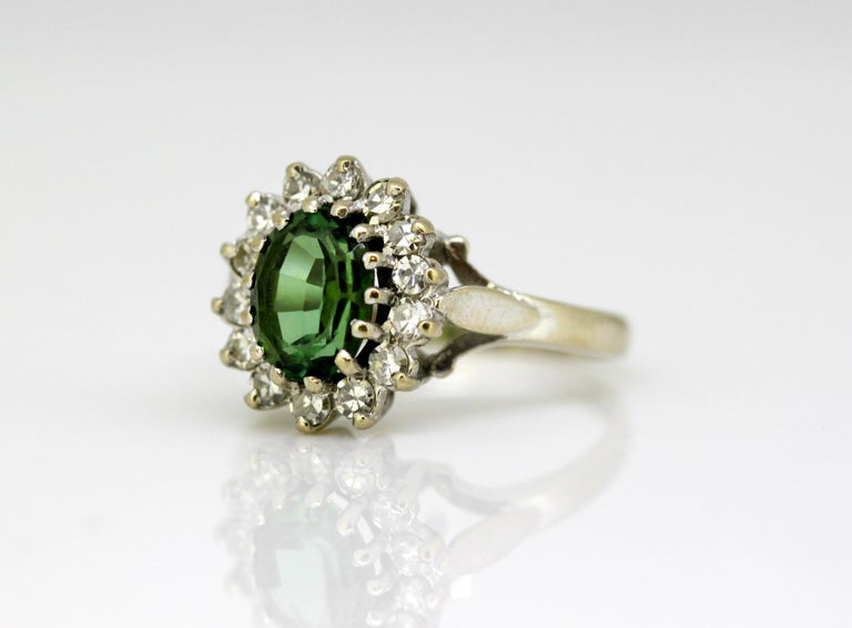 Vintage 18k white gold ladies ring with green tourmaline and diamonds. Made in London 1977 Fully hallmarked.  Dimensions - Ring size : 2.4 x 1.9 x 1.3 cm Finger Size (UK) = K (US) = 5 1/2 (EU) = 50 1/4 Weight : 6 grams total  Tourmaline -  Cut :
