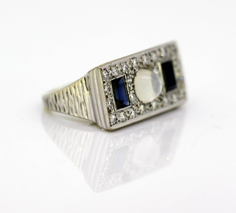 Vintage 18k white gold ring with moonstone, blue sapphire & diamonds Circa 1950s Hallmarked 18K  Dimensions - Ring Size : 2.3 x 2.4 x 1.15 cm Finger Size : (UK) = J (US) = 5 1/4 (EU) = 49 1/2 Weight: 9 grams total  Diamond -  Cut : Round Total