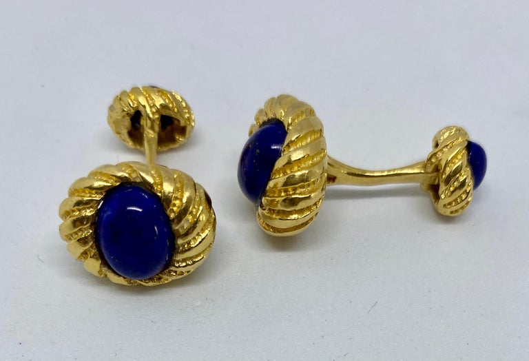 A classic design, these double-sided cufflinks feature four cabochon-cut lapis ovals set in 18K yellow gold.  These cufflinks were designed by Jean Schlumberger for Tiffany & Co. However, some overly zealous cleaning buffed out the marks on the