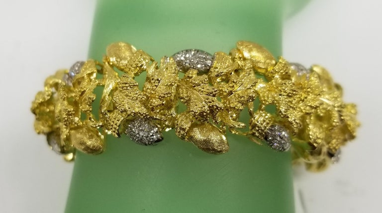 Vintage 18k yellow gold diamond acorn and leaf bracelet, containing 70 round single cut diamonds; color