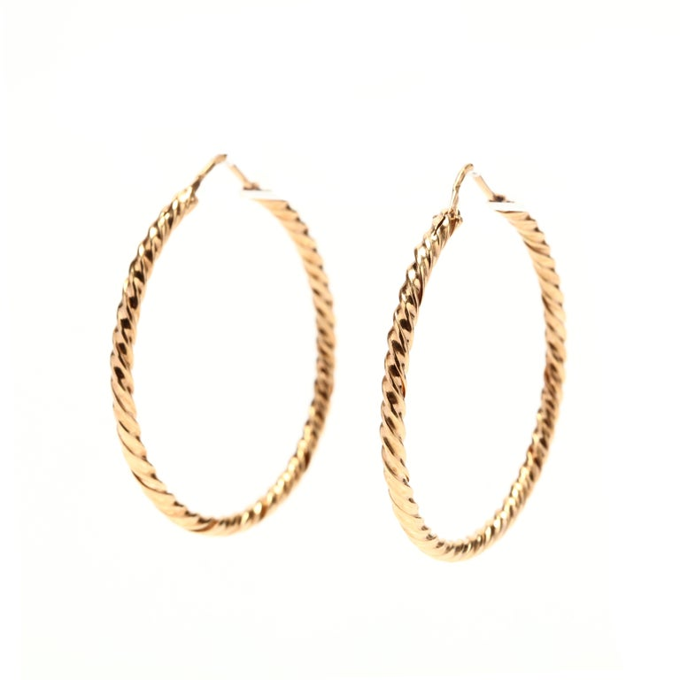 Vintage 18 karat yellow gold twist hoop earrings.  Length: 1.5 in.  Width: 3 mm  3.93 dwts  * Please note that this is a vintage item and may show signs of wear. It has been cleaned.  * Please feel free to message us with any questions1