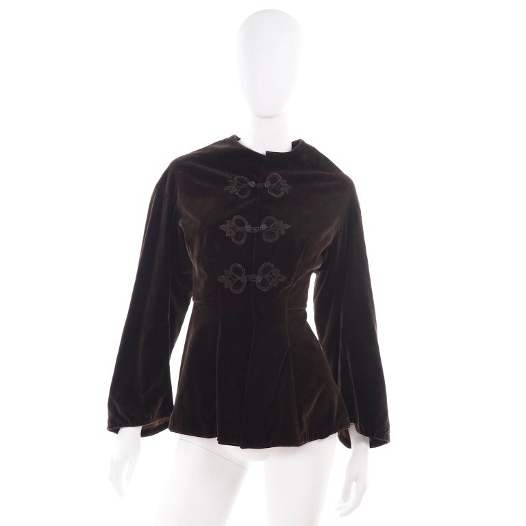 This is an absolutely beautiful Edwardian basque style women's  jacket with a peplum and fun trumpet sleeves. It closes with hidden hooks and eyes and  three double frog closures with decorative soutache loops.  It may be summer, but we couldn't
