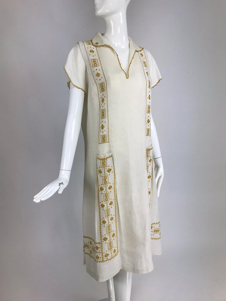 Vintage 1920s Hand embroidered Arts and Crafts linen day dress.The Arts and Crafts Movement of the early 20th century was a philosophy and way of life that encompassed all aspects of living, including home furnishings, publishing, and fashion. This