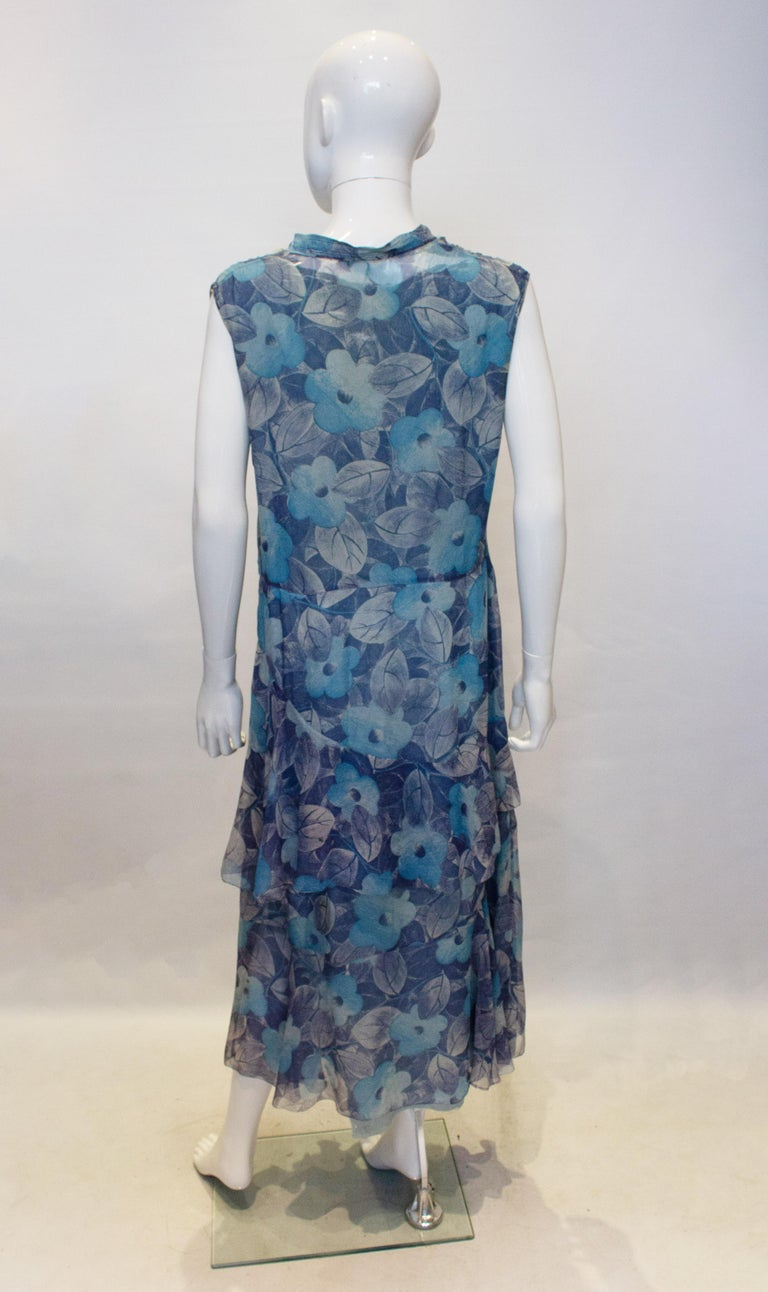 A pretty vintage silk dress from the 1920s  in an attractive floral print. The dress has a v neckline and is lined in silk that is a little damaged but could be replaced. It has a side popper opening and frill at the drop waist leval.