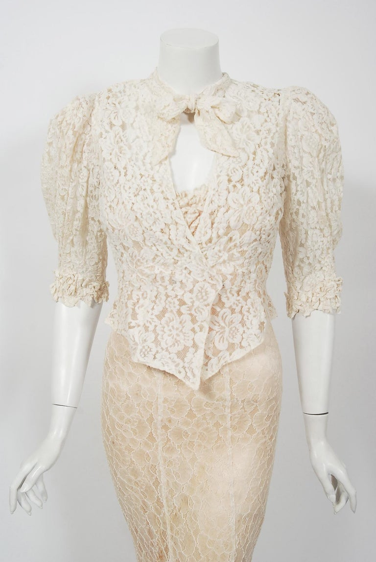 A breathtaking ivory white lace gown ensemble from the 1930's era of