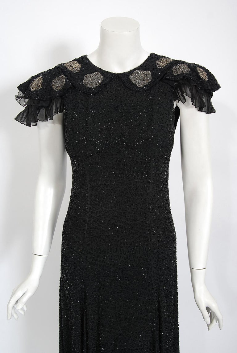 Undiminished by time, this early 1930's black beaded couture dress still casts its magical spell. This exceptional French beauty is fashioned in the highest quality black silk that has been lavishly embellished with glass micro-beads throughout. I